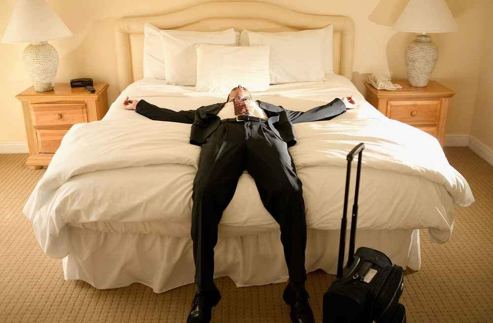 man sleeping in hotel
